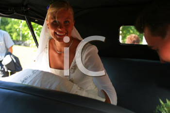 Royalty Free Photo of a Bride in a Car