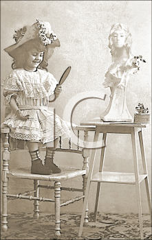 Royalty Free Photo of a Child Looking in a Hand Mirror