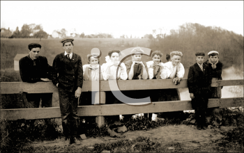 Royalty Free Photo of a a Group of People Standing Along a Fence
