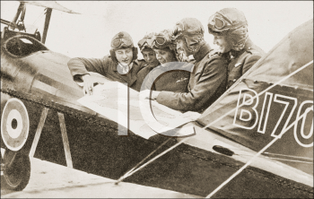 Royalty Free Photo of Men Looking at a Map Beside an Airplane