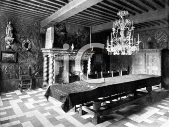 Royalty Free Photo of an Old Dining Room With Furnishings a Fireplace and a Chandelier