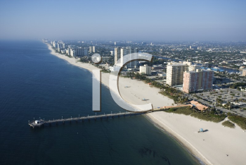 Royalty Free Photo of an Aerial View of Waterfront Buildings and Pier Over the Ocean at Pompano Beach, Florida