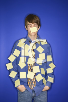 Royalty Free Photo of a Teenage Boy Covered With Blank Sticky Notes
