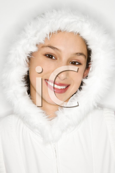Royalty Free Photo of a Teen Girl Wearing a Fur Lined Coat Hood and Smiling
