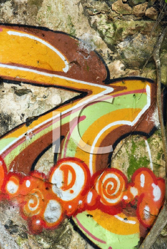 Royalty Free Photo of a Concrete Wall Covered With Graffiti