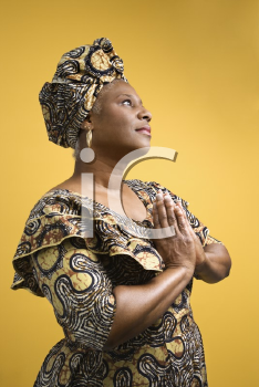 Royalty Free Photo of an African American Woman Dressed in African Costume
