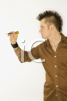 Royalty Free Photo of a Side View of a Man With a Mohawk Holding a Dart