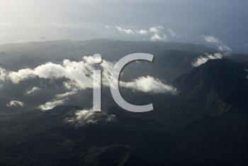 Royalty Free Photo of an Aerial View of a Mountain Landscape With Clouds in Maui, Hawaii