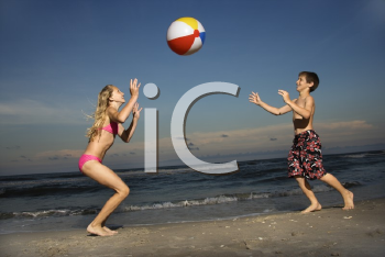 Royalty Free Photo of a Boy and Girl Playing on the Beach