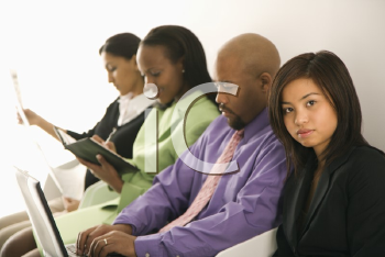 Royalty Free Photo of a Business Group of People Looking at Laptop and Papers