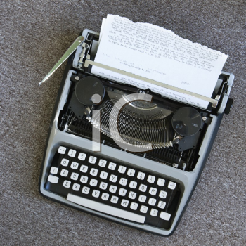 Royalty Free Photo of an Overview of a Typewriter With Paper That Has Been Typed On