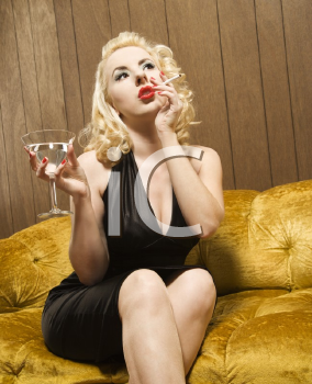 Royalty Free Photo of an Attractive Woman Holding a Martini and a Cigarette