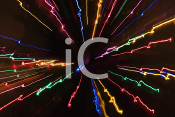 Royalty Free Photo of Multicolored Lights Forming a Radial Starburst Pattern From Motion Blur