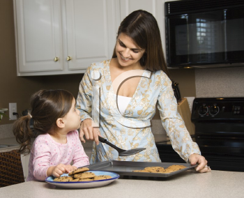 Royalty Free Photo of a Mother and Daughter Baking Cookies