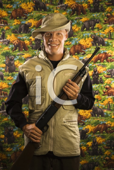 Royalty Free Photo of a Man Holding a Rifle