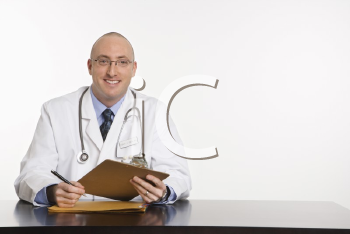 Caucasian mid adult male physician sitting at desk smiling.