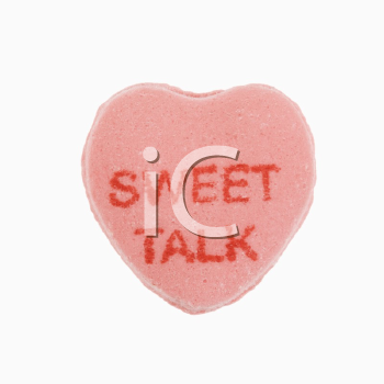 Royalty Free Photo of a Pink Candy Heart that Says Sweet Talk