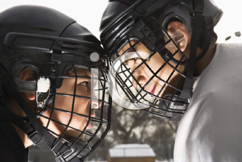 Royalty Free Photo of Two Ice Hockey Players in Uniform Facing Off Trying to Intimidate Each Other