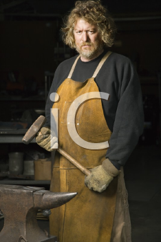 Royalty Free Photo of a Metal Smith in His Workshop