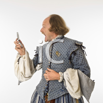 Royalty Free Photo of William Shakespeare in Period Clothing  Yelling at a Cellphone