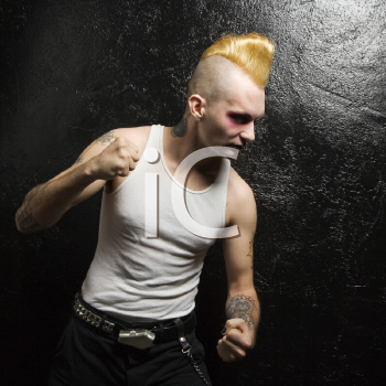 Royalty Free Photo of a Punk With Clenched Fists