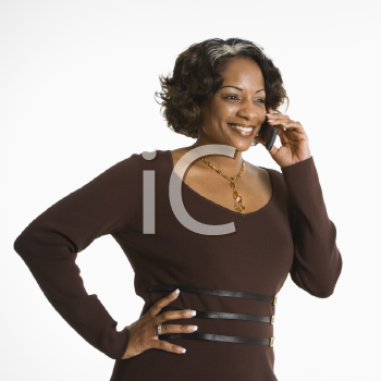 Royalty Free Photo of a Woman Holding a Telephone to Her Ear and Smiling