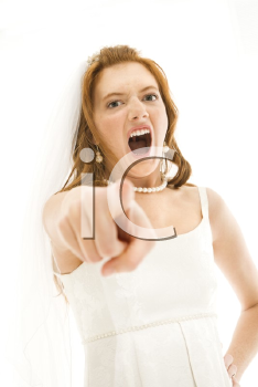 Caucasian bride screaming and pointing finger at viewer.