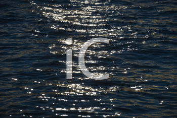 Royalty Free Photo of Sunlight Hitting Waves in the Water
