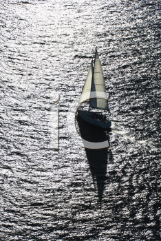 Royalty Free Photo of an Aerial View of a Back Lit Sailboat in Sydney, Australia