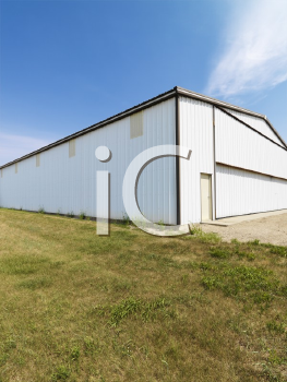 Royalty Free Photo of a Plain Aluminum Building in a Rural Setting