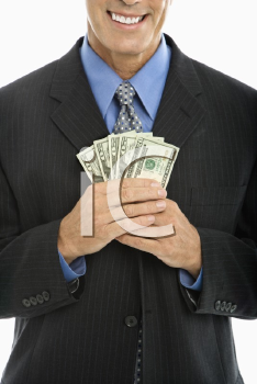 Royalty Free Photo of a Middle-Aged Businessman Holding a Fist Full of Cash