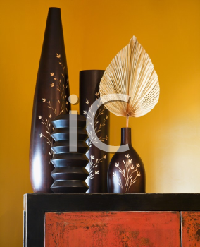 Royalty Free Photo of a Still Life of Interior With Asian Vases on a Dresser