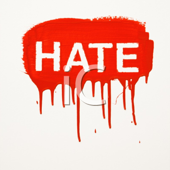 Hate painted on wall in red with drippings.