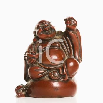 Happy laughing Buddha figurine with hand raised in blessing on white background.