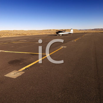 Royalty Free Photo of a Plane Parked on Tarmac at Canyonlands Field Airport, Utah, United States