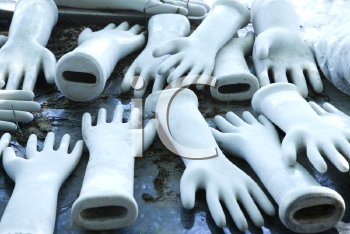 Royalty Free Photo of a Table Full of Ceramic Hand Figurines