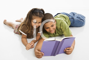 Royalty Free Photo of a Brother and Sister Reading a Book Together