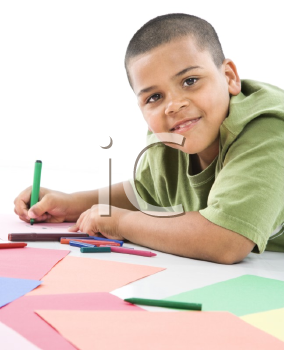 Royalty Free Photo of a Boy Coloring With Crayons