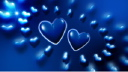 Royalty Free Video of Hearts Rotating Around Larger Hearts