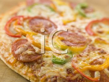 Royalty Free Photo of a Pepperoni and Pepper Pizza