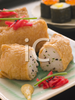 Royalty Free Photo of Sushi Tofu Pouches With Red Pickled Ginger