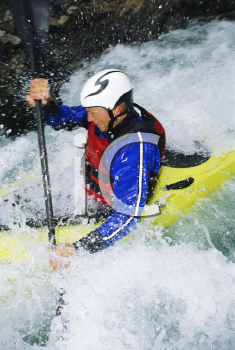 Royalty Free Photo of a Kayaker in Rapids