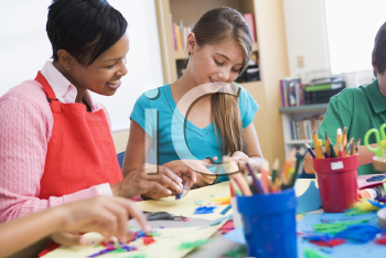Royalty Free Photo of a Teacher and Student in Art Class