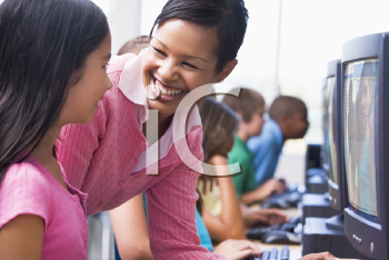 Royalty Free Photo of a Teacher Talking to a Student in Computer Class