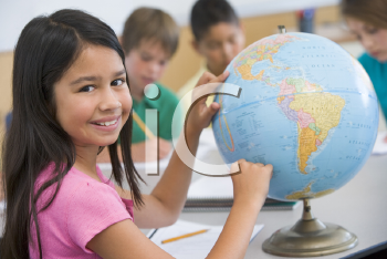 Royalty Free Photo of a Student Pointing at a Globe