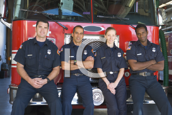 Royalty Free Photo of Firefighters Leaning on the Truck