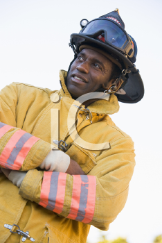Royalty Free Photo of a Firefighter With His Arms Crossed