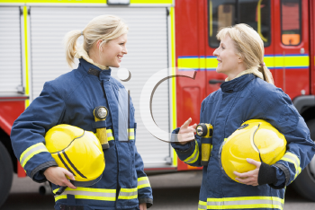 Royalty Free Photo of Two Women Firefighters Talking