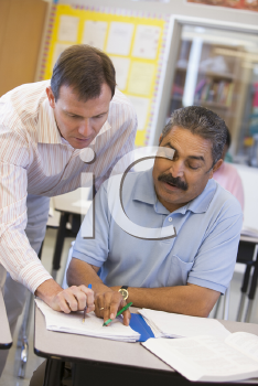 Royalty Free Photo of a Teacher With an Adult Student