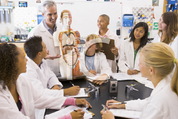 Royalty Free Photo of Students With Their Teacher in Biology Class
